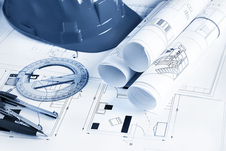 autocad: Engineer worplace with blueprints, compass, pen, protractor  and safety helmet Stock Photo