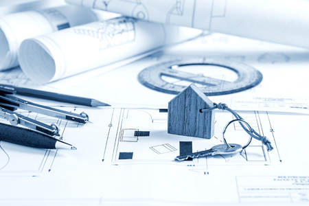 architect tools: Architect worplace with blueprints, tools and house key