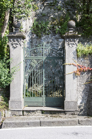 open gate: wrought-iron gate in a italian villa