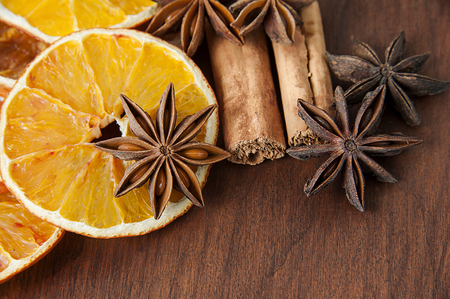 Christmas spices. Cinnamon sticks, anise stars and sliced of dried orange photo