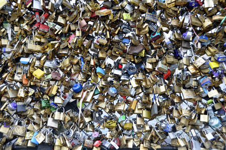 PARIS - August 20: Love Padlocks at Pont des Arts on Agust 20, 2013, in Paris. The thousands of locks of loving couples symbolize love forever.