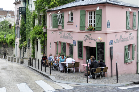PARIS, FRANCE - August 20: Historical bistro on Montmartre - La Maison Rose - Pink House. Maurice Utrillo painted it around 1912, in Paris, France on August 20, 2014