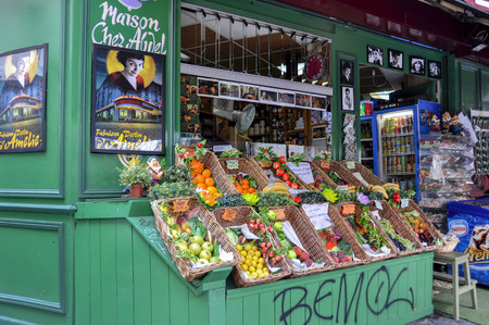 gained: PARIS - August 1: Marché de la Butte. The Epicerie Fine, is a greengrocer in the Montmartre area, which has gained fame since its appearance in the film Amelie, as shown in the window on August 20, 2014 in Paris, France.