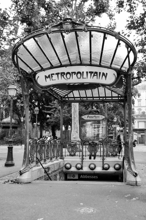 montmartre: PARIS, FRANCE - 20 August 2014: The entrance to the Abbesses station for the Paris Metro. Famous art nouveau built in 1912 and one of only two remaining with a glass canopy supported by an ornate metal structure.
