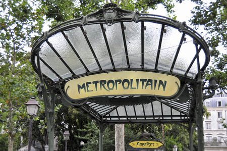 PARIS, FRANCE - 20 August 2014: The entrance to the Abbesses station for the Paris Metro. Famous art nouveau built in 1912 and one of only two remaining with a glass canopy supported by an ornate metal structure.