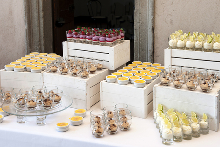 Selection of decorative desserts on buffet table