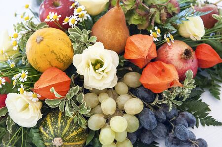 Beautiful autumn composition with flowers and fruit photo