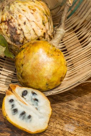 Annona scaly, sugar apple fruit. Divided half annona cherimola fruit. Organic custard apple, sweetsop fruit.Organic fruit concept. Selective focus. Stock Photo