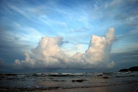 hugh: Hugh cloud over the sea on sunrise Stock Photo
