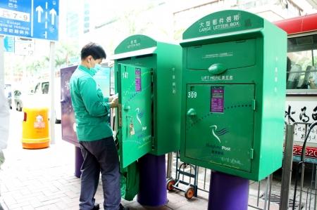 post man: Mar 23, 2012 - Wan Chai, Hong Kong Island, Hong Kong. Post man collect in postbox Editorial