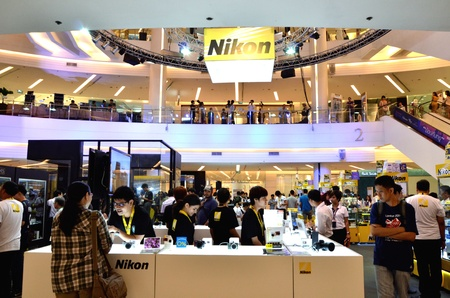 paragon: BANGKOK, THAILAND - AUG 22  Peoples visiting Nikon Day 2013, the largest photography and imaging show by Nikon Sale Thailand on 22 August at 1st floor Fashion Hall Siam Paragon, Bangkok, Thailand Editorial