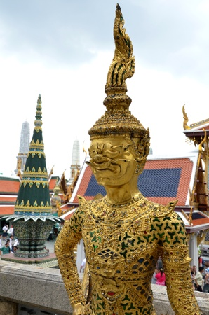 Golden Kinnari statue at Temple of the Emerald Buddha  Wat Pho Kaew , Bangkok photo