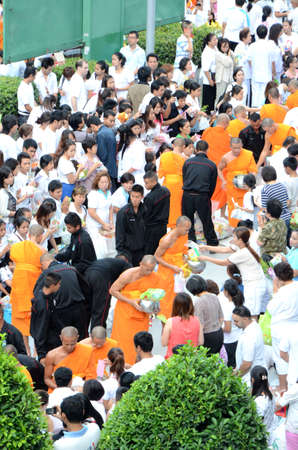 perishable: Bangkok, Thailand - July 7, 2012  Morning alms-offering to 12600 Buddhist monks to celebrate 2600 anniversary of the Lord Buddha s Enlightenment at Asokemontri road, Sukhumvit intersection, Bangkok  Editorial