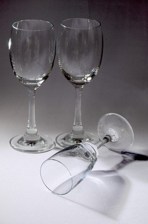 An empty champagne and wine glasses in studio lighting photo