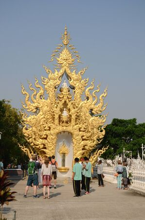 CHIANGRAI, THAILAND - MAR 2  Unidentified travelers visit Wat Rong Khun a famous white temple at northen thailand on 2 March 2014 at Wat Rong Khun, Chaingrai, Thailand