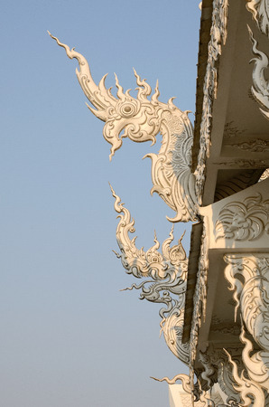 Naga or Snake Dragon head detail in Wat Rung Khun temple, Chiang Rai Thailand photo