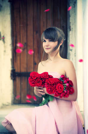 alone girl: Young beautiful girl with a bouquet from roses