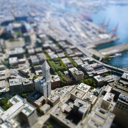 Focused skyscraper in the middle of Seattle city with tilt-shift effect