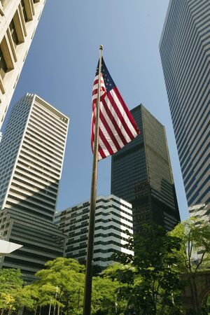 American Flag in the middle of skyscrapers photo