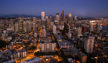 Seattle city nightlife after a sunset from the Space Needle photo