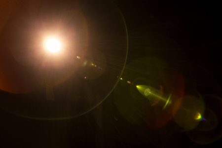 Lomography camera lens flare on a black background photo