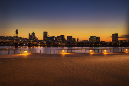 willamette: Portland, Oregon city skyline panorama with Hawthorne bridge. Colorful sunset sky and light reflection on the Willamette river.