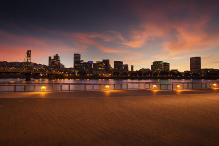 portland oregon: Portland, Oregon city skyline panorama with Hawthorne bridge. Beautiful twilight with pink clouds and light reflection on the Willamette river. Stock Photo