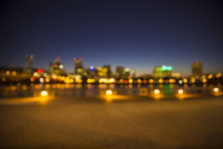 Out of focus Portland skyline in Oregon with Hawthorne Bridge and Willamette River photo