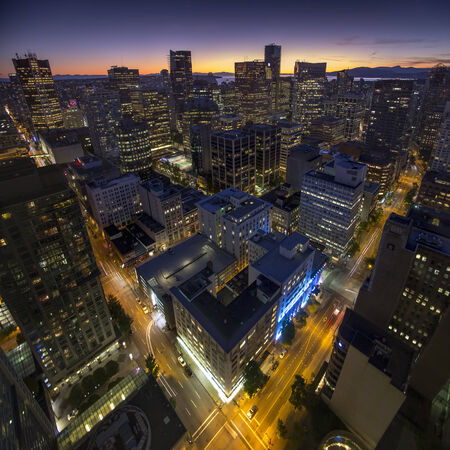 Streets of downtown Vancouver in British Colombia, Canada during late sunset Standard-Bild