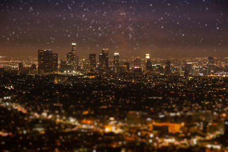 bird's eye view: Tilt-shift of Downtown Los angeles cityscape in early night with glowing stars on the sky.