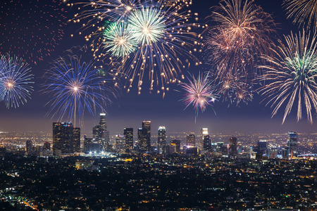 Downtown Los angeles cityscape with flashing fireworks celebrating New Year 스톡 콘텐츠