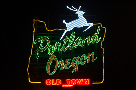 Sign in Portland, Oregon with jumping deer and image of oregon