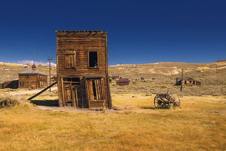 Abandoned and crooked Western building where business was closed after the golden rush