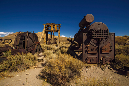 goldrush: Old gold mine machines and tools abandoned in Bodie Ghost Town, California, USA Editorial