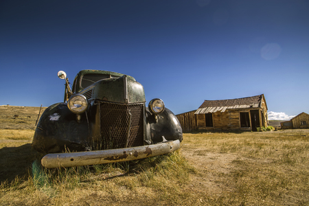 abandoned car: Abandoned historical car with main headlights and front grill in ghost town Bodie Editorial