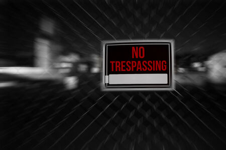 Private property no trespassing sign warning on a chainlink fence Stock Photo