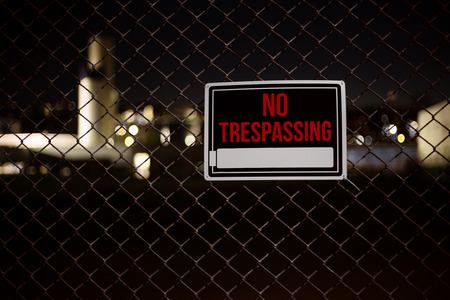 Private property no trespassing sign warning on a chainlink fence Stock Photo - 34439035