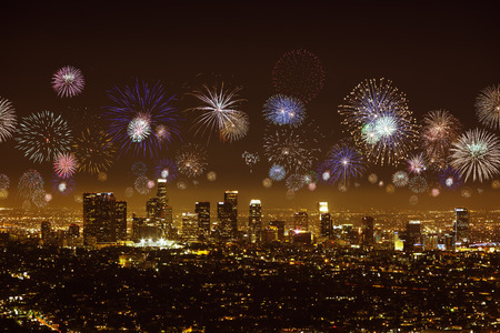 Downtown Los angeles cityscape with flashing fireworks celebrating New Year Stock Photo