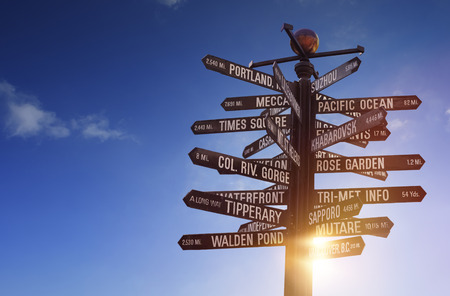 direction board: Travel the World! World Landmarks Signpost with sun in the background and free copy space for your text Stock Photo