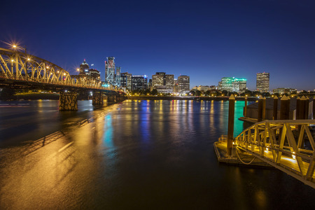 Portland City Skyline during late sunset with Hawthorne bridge in front of the city