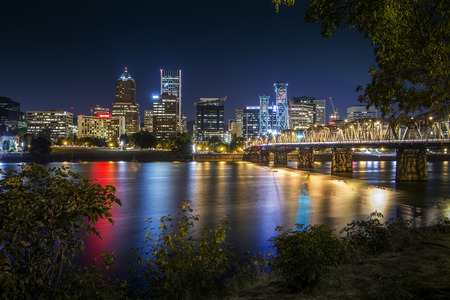 Portland City Skyline during early night with Hawthorne bridge crossing the Willamette River