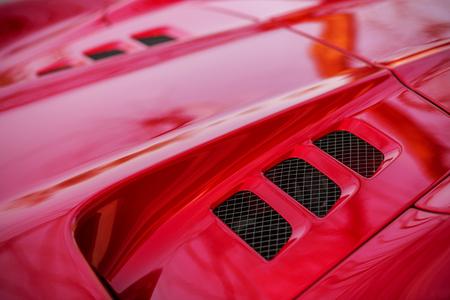 vents: Detail of red super-sport car vents on a bonnet