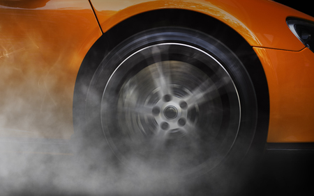car wheel: Detail of a sport car with spinning wheel, smoking, doing drifts and burnouts Stock Photo