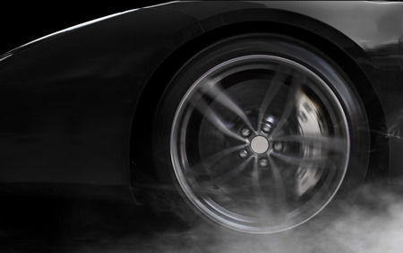 Isolated generic black sport car with detail on wheel with red breaks drifting and smoking on a black background Standard-Bild