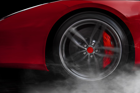 Isolated generic red sport car with detail on wheel with red breaks drifting and smoking on a black background