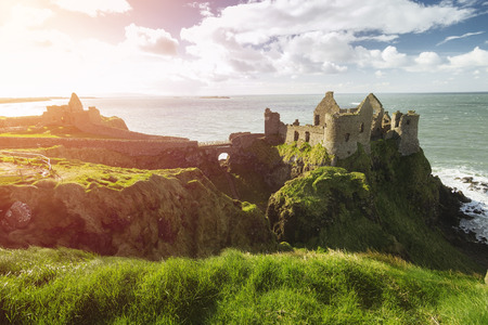 Dunluce Castle, Antrim, Northern Ireland during sunny day with semi cloudy sky Stock Photo