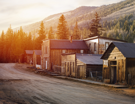St. Elmo Old Western Ghost Town in the middle of mountains during Sunrise Editorial