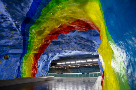 STOCKHOLM, SWEDEN - March 5, 2017: Underground metro Stadion station with rainbow design painting in Stockholm, Sweden dedicated to olympic games in Sweden.