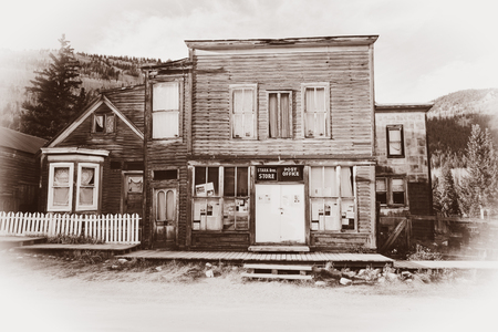 Vintage Photo of Old Western Post Office Building in the middle of a western town hidden in mountains