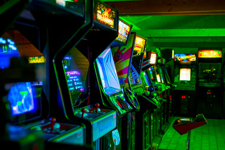 PRAGUE - CZECH REPUBLIC, August 5, 2017 - Old vintage arcade game in a room room full of of 90s Era Old Arcade Video Games with blue and gree light Editorial